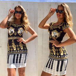 4298d35c18e9 Dámske čierne vzorované šaty NI GOLD CRYSTALS